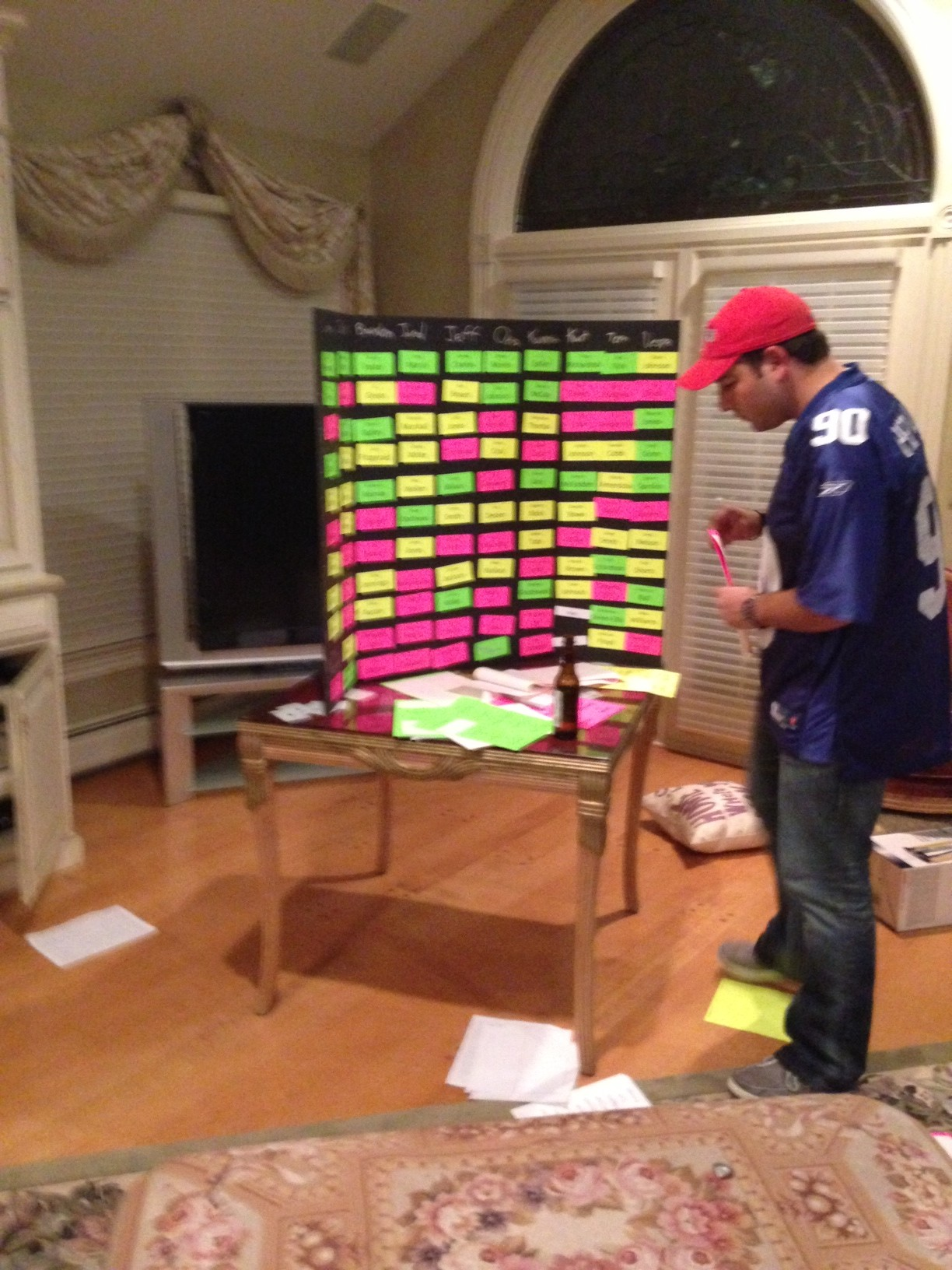 "Fantasy football enthusiasts conduct a ""live"" fantasy draft.
